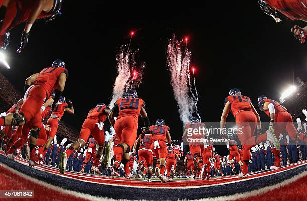 The Arizona Wildcats run out onto the field before the college football game aa\USC Trojans at Arizona Stadium on October 11, 2014 in Tucson, Arizona.