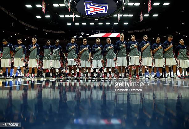 The Arizona Wildcats stand attended for the National Anthem before the college basketball game against the Colorado Buffaloes at McKale Center on...