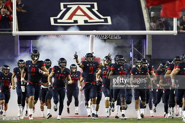 The Arizona Wildcats take the field prior to the college football game against the Washington Huskies at Arizona Stadium on September 24 2016 in...