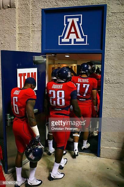 The Arizona Wildcats walk into the locker room following warm ups to the college football game against the Oregon Ducks at Arizona Stadium on...