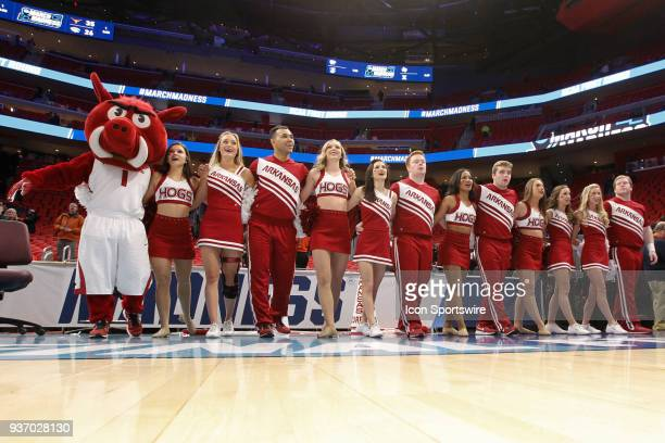 The Arkansas cheerleaders and mascot sing the school's alma mater at the conclusion of the NCAA Division I Men's Championship First Round basketball...