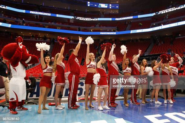 The Arkansas cheerleaders and mascot wave to the crowd at the conclusion of the NCAA Division I Men's Championship First Round basketball game...