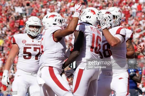 The Arkansas offensive line congratulates wide receiver La'Michael Pettway after a touchdown reception during the Arkansas Razorbacks 5520 win over...