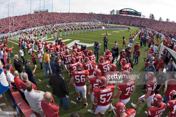 The Arkansas Razorback team runs onto the field before their game against the Mississippi State Bulldogs at War Memorial Stadium November 17 2007 in...