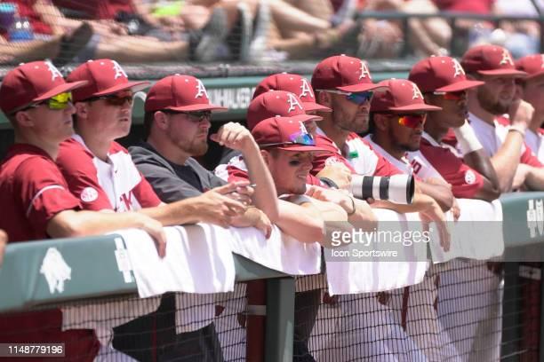 The Arkansas Razorbacks bench looks on during the NCAA Super Regional baseball game between the Arkansas Razorbacks and Ole Miss Rebels on June 8,...