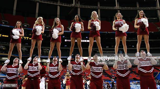 The Arkansas Razorbacks cheerleaders perform against the South Carolina Gamecocks during the second round of the SEC Men's Basketball Tournament at...