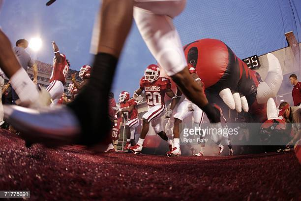 The Arkansas Razorbacks run out of their tunnel for a game against the University of Southern California Trojans in the second quarter on September...
