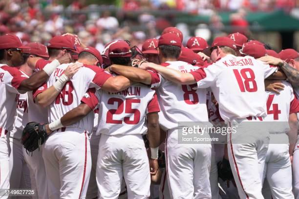 The Arkansas Razorbacks team huddles before Game 3 of the NCAA Super Regional baseball game between the Arkansas Razorbacks and Ole Miss Rebels on...