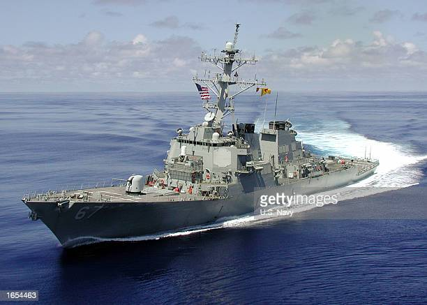The Arleigh Burke class guided missile destroyer USS Cole is shown at sea approximately one month before being attacked by a terroristsuicide mission...