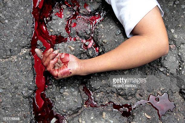 The arm of a killed boy is seen on the pavement in the touristic city of Acapulco Guerrero state Mexico on August 15 2011 More than 40000 people have...