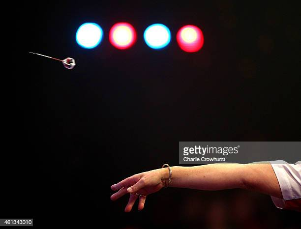 The arm of Martin Adams of England in action during the mens final match against Scott Mitchell of England during the BDO Lakeside World Professional...