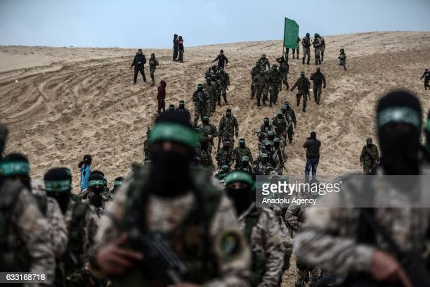 The armed branch of Hamas Izz adDin alQassam Brigades members attend the opening ceremony of the monument for assassinated Tunisian aircraft engineer...