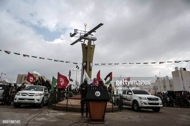 The armed branch of Hamas Izz adDin alQassam Brigades spokesman Abu Obeida speaks during the opening ceremony of the monument for assassinated...