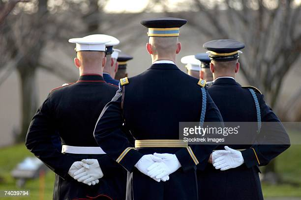 the armed forces honor guard prepares for the arrival of president gerald r. ford's body in front of the gerald r. ford presidential library and museum january 2 in grand rapids, michigan. - hands behind back stock pictures, royalty-free photos & images