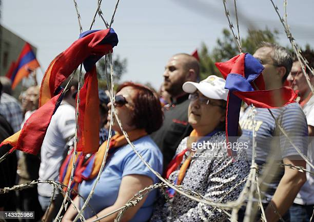 The Armenian flag is tied around barbed wire as Lebanese Armenians protest outside the Turkish embassy in Rabieh northeast of Beirut to commemorate...