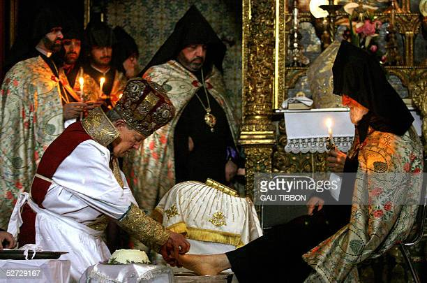 The Armenian Patriarch of Jerusalem Tarkum Menogian conducts the traditional Washing of the Feet ceremony at the Armenian Church in Jerusalem's Old...