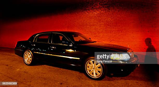 The armored Lincoln town car has bullet proof windows.
