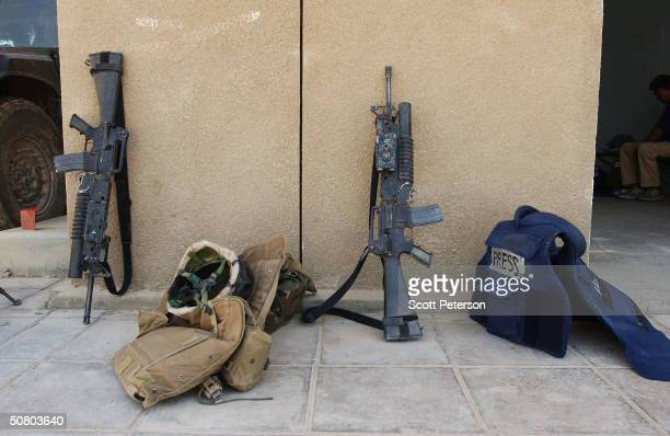 The armored vest of an embedded journalist lies next to guns and vests of US Marines of 2nd Battalion 1st Marine Regiment May 5 2004 in Fallujah Iraq...