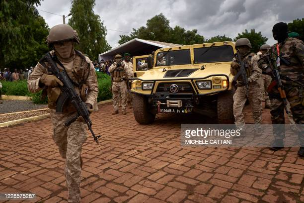 The armoured vehicle of Colonel Assimi Goita , president of the CNSP , arrives at the funeral of former Mali President General Moussa Traore in...
