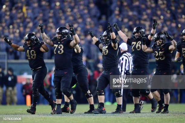 The Army Black Knights celebrate a first down at the end of the third quarter during the game against the Navy Midshipmen at Lincoln Financial Field...