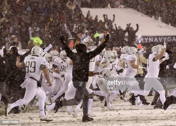 The Army Black Knights celebrates the win over the Navy Midshipmen on December 9 2017 at Lincoln Financial Field in Philadelphia PennsylvaniaThe Army...