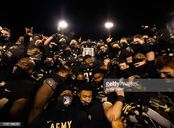 The Army Black Knights pose with the Commander-in-Chief's Trophy after defeating the Air Force Falcons 10-7 at Michie Stadium on December 19, 2020 in...
