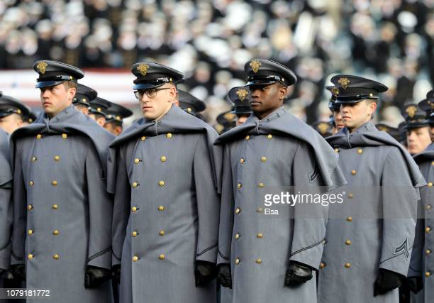 The Army cadets hold their position after they marched on the field before the game between the Army Black Knights and the Navy Midshipmen at Lincoln...