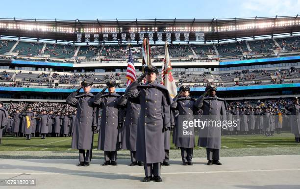 The Army cadets salute after they marched on the field before the game between the Army Black Knights and the Navy Midshipmen at Lincoln Financial...