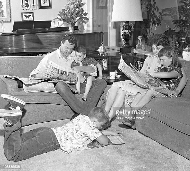 The Arness family at home James Arness with Rolf Virginia with daughter Jenny Lee and Craig on the floor Image date May 4 1957
