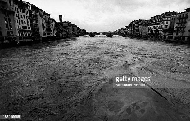 The Arno River in spate flowing under the bridge of Santa Trìnita during the flood Florence November 1966