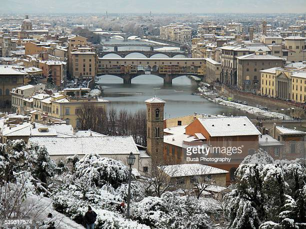 The Arno River in winter with snow, as seen from Piazzale Michelangelo. Tuscany, Italy