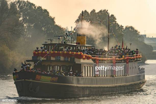 the arrival of sinterklaas by steamboat in the city of kampen - vintage steamship stock photos and pictures