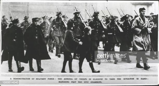 The arrival of soldiers in Glasgow to take the situation in hand during the strike - marching past the city chambers, Glasgow, Scotland. 'A...