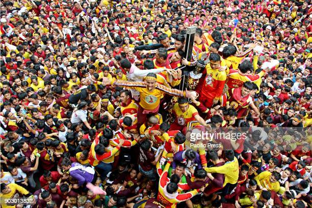 The arrival of the Black Nazarene procession and devotees trying to touch the rope of Black Nazarene statue while entering at Chinese Filipino Peace...