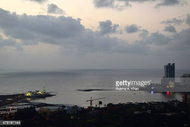 The arrival of the Mumbai monsoon on the Haji Ali Dargah skyline and the subsequent first showers on June 7 2015 in Mumbai India