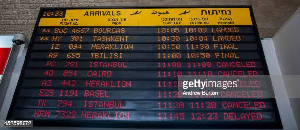The arrivals gate board shows cancelled flights at terminal three at Ben Gurion Airport on July 24 2014 in Tel Aviv Israel The Federal Aviation...