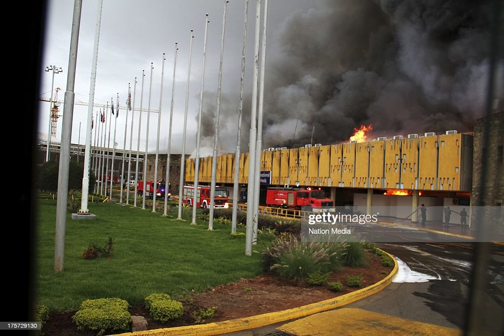 (Not for sale to The Star (Kenya), Capital FM, The People, Citizen TV, Kenya Broadcasting Corporation) The Arrivals Section of the Jomo Kenyatta International Airport on August 07, 2013 in Nairobi, Kenya. Passengers were unable to leave after JKIA was closed indefinitely after fire gutted part of the international arrivals lobby.