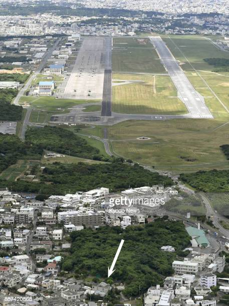 The arrow in this file photo taken on July 24 indicates the location of a nursery school in Ginowan in Japan's southernmost island prefecture of...