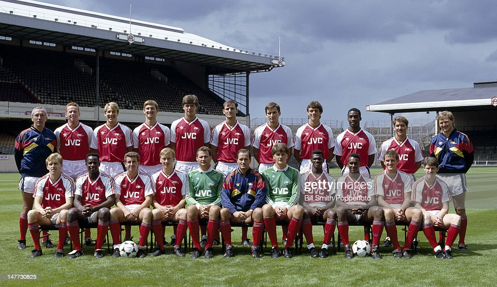 The Arsenal 1st team squad at Highbury Stadium in London, circa August 1988. Back row (left-right): Theo Foley (assistant manager), Perry Groves, Paul Merson, Tony Adams, Niall Quinn, Steve Bould, Alan Smith, David O'Leary, Gus Caesar, Kenny Sansom, Gary Lewin (physiotherapist). Front row: Kevin Richardson, Michael Thomas, Nigel Winterburn, Lee Dixon, Rhys Wilmot, George Graham (manager), John Lukic, Paul Davis, David Rocastle, Martin Hayes and Brian Marwood.