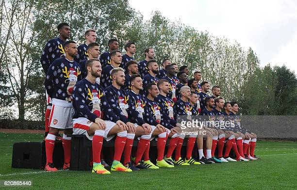 The Arsenal 1st team squad in their Christmas Jumpers to support Save the Children Christmas Jumper Day at London Colney on October 21 2016 in St...