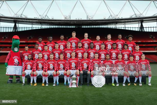 The Arsenal 1st team squad in their Christmas Jumpers to support Save the Children Christmas Jumper Day at Emirates Stadium on October 31 2017 in...