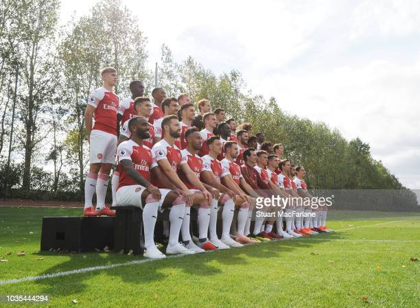 The Arsenal squad applaud a young fan as he joins the team picture 1st team photocall at London Colney on September 18 2018 in St Albans England