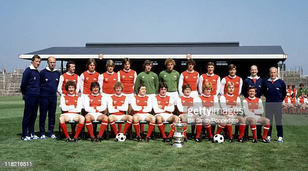 The Arsenal 1st team squad with the FA Cup at Highbury August 1979 Back row Terry Neill Don Howe Liam Brady Steve Gatting John Devine Steve Walford...