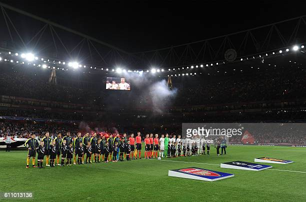 The Arsenal and Basel teams line up before the UEFA Champions League match between Arsenal FC and FC Basel 1893 at Emirates Stadium on September 28...