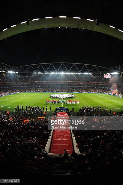 The Arsenal and Bayern Munich teams line up before the UEFA Champions League Round of 16 first leg match between Arsenal FC and Bayern Muenchen at...