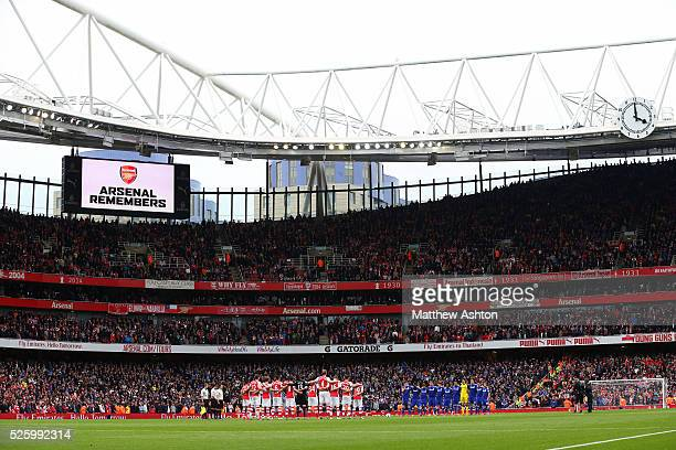 The Arsenal and Chelsea teams line up for a minutes silence at the Emirates stadium to commemorate the anniversary of the Bradford City fire