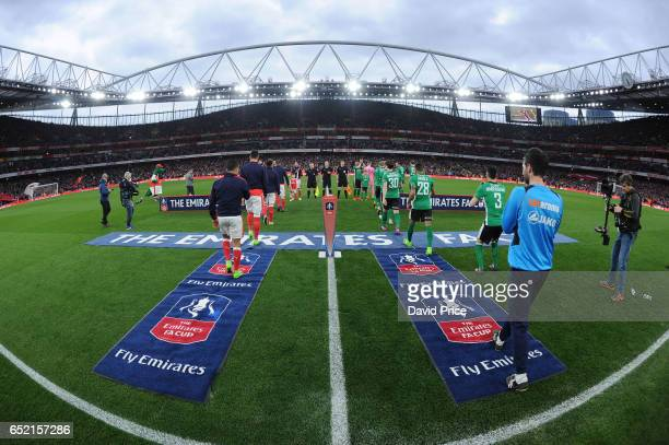 The Arsenal and Lincoln teams line up before the match between Arsenal and Lincoln City at Emirates Stadium on March 11 2017 in London England