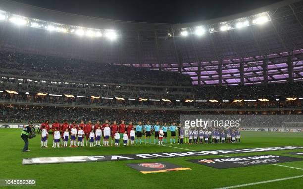 The Arsenal and Qarabag teams line up before the UEFA Europa League Group E match between Qarabag FK and Arsenal at on October 4 2018 in Baku...