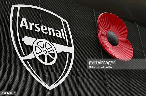 The Arsenal badge next to a giant poppy for remembrance day before the Barclays Premier League match between Arsenal and Tottenham Hotspur at...