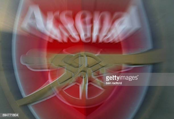 The Arsenal club crest attached to the side of the recently finished Emirates Stadium home to Arsenal Football Club in North London